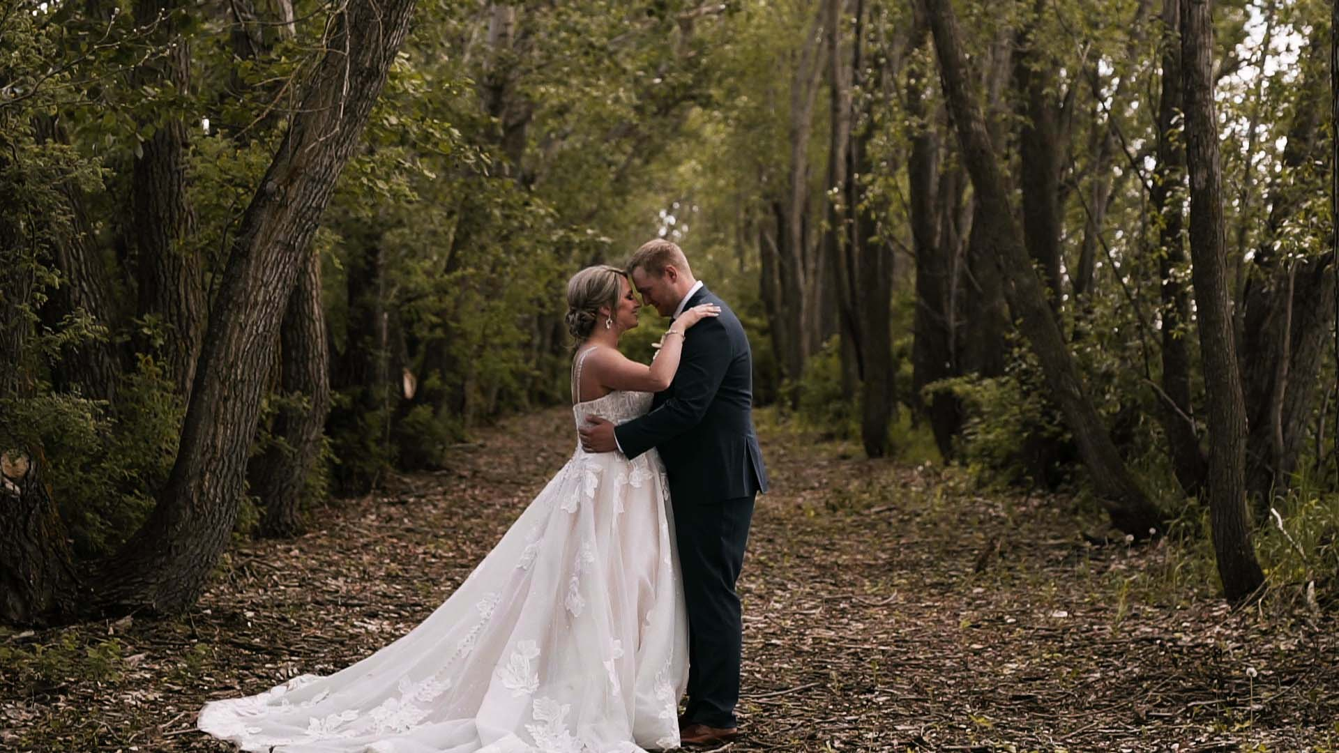 Couple holding each other in the woods